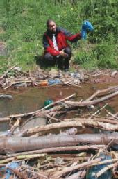Phil Gregory  Cleans Local Stream