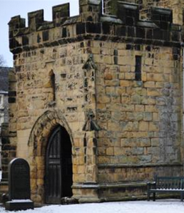 Tideswell Church South door. (note windows to the small office)